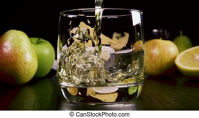 Slow motion strong alcoholic drink pour into a glass near...