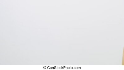 Slow motion studio portrait of a woman touching her skin