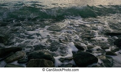 Slow motion the wave curls on the shore - Slow motion the...