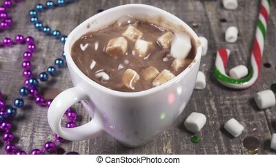 Slow motion throw marshmallows in a mug of hot chocolate -...