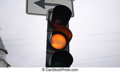 SLOW MOTION: Traffic Light Flashing, Signal Orange light close up in Germany Daylight