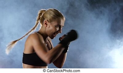 Slow motion. Training a boxer girl hands hit the target.