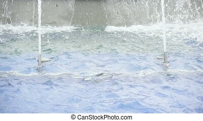 Slow motion two nozzles with jets of water in a fountain
