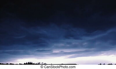 Slow motion video clip of night sky with lightning and stormy clouds.
