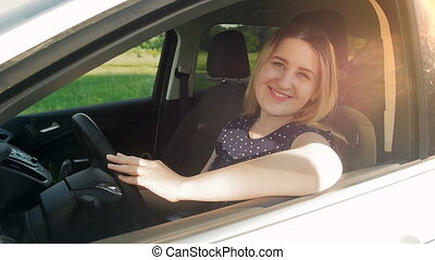 Slow motion shot of woman sitting in car in center, buying