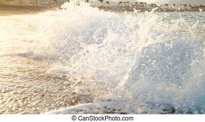Slow motion video of big ocean waves breaking on the sandy...