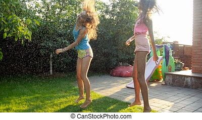 Slow motion video of cheerful teenage girls dancing and...