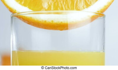 Slow motion video of glass being filled with fresh orange...