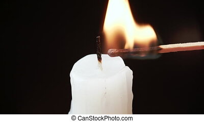 Slow motion video of lighting a candle