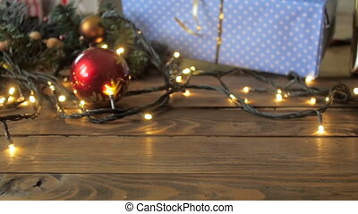 Slow motion video of red Christmas bauble falling and...