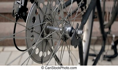 Slow motion video of rotating vinatge bicycle wheel