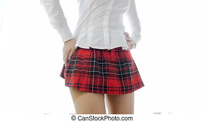 slow motion video of sexy slim student girl in nylong stockings and red checkered skirt