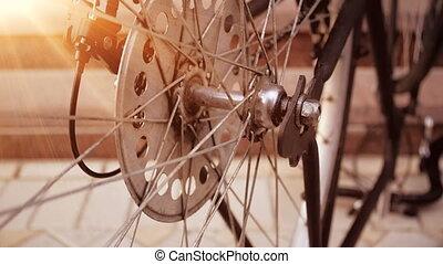 Slow motion video of vinatge bicycle wheel slowly rotating...