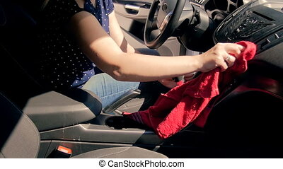 Slow motion video of young female driver cleaning her with...