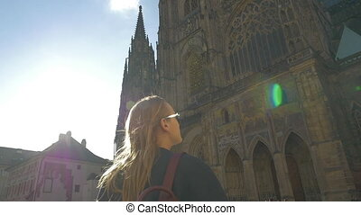 Slow motion view of woman watching on the Votive Church and then taking it picture, Vienna, Austria
