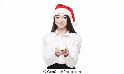 slow motion young attractive businesswoman blowing silver confetti celebrating for Christmas and New Year.