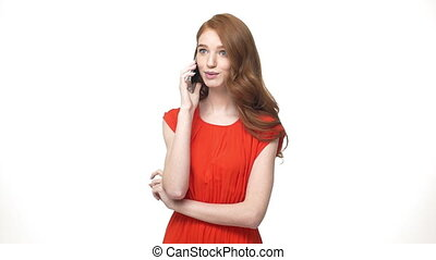 Slow motion young beautiful caucasian woman talking on phone with shyness facial expression. Isolated over white background