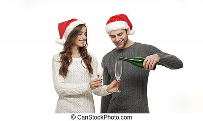 Slow-motion young couple enjoy drinking champagne celebrate for christmas fun together feeling attraction.