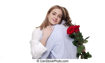 Slow motion Young Couple hugging on date holding red rose flower.