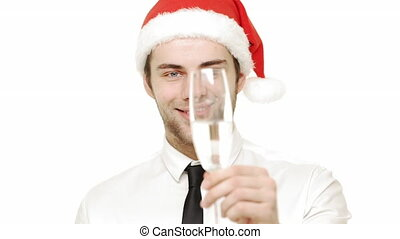Slow motion young handsome businessman giving a smile and giving a cheer with champagne over white background.