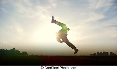 Slow-motion - young male Parkour tricker jumper performs...