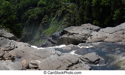 View of cascading water falling over the rocks at Canyon...