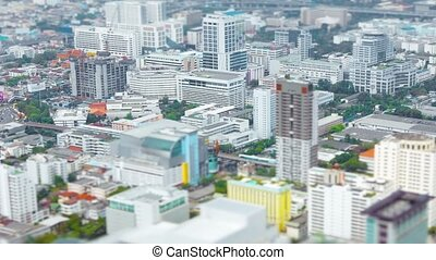 Slow, panning shot of Bangkok, Thailand, from the top of a tall tower.