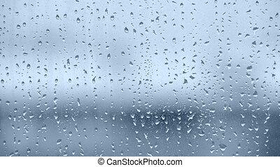 Slow rain drops in blue