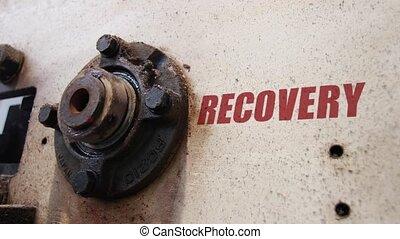 Slow recovery conceptual metaphor - Machine wheels rotating...