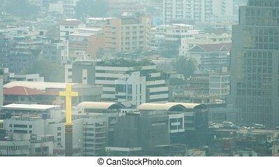 Slow Retreating Shot of Downtown Bangkok, Thailand on a Hazy Day