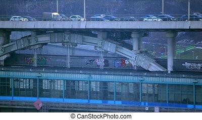 Slow road traffic versus fast mass transit system. Telephoto lens video