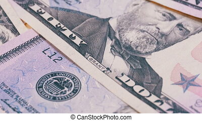 Slow Rotating Fifty Dollars American Bills. Background with...