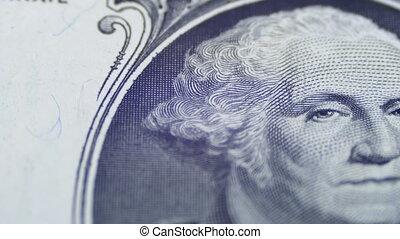 Slow Rotating George Washington Portrait on One Dollar Bill...