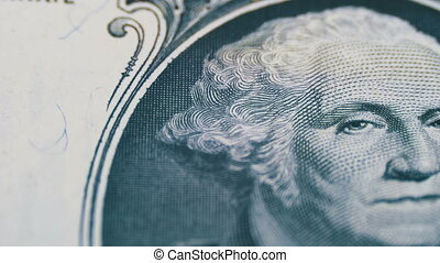 Slow Rotating George Washington Portrait on One Dollar Bill...