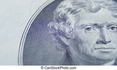 Slow Rotating Thomas Jefferson Face on Two Dollar Bill in...