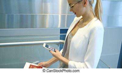 Slow shooting of woman taking photos of passport on phone