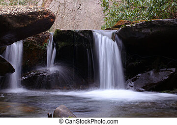 Slow Shutter Speed Waterfall Photography of a Small Fresh Water River in the Mountain Woods.