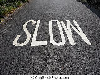 slow sign on street
