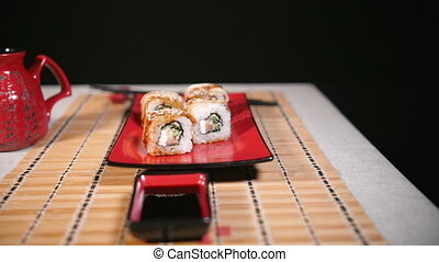 Slow Slide Motion Of Sushi For Two