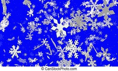 Slowly falling white snow flakes on blue