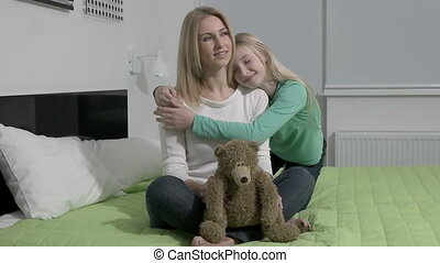 slowmotion - beautiful blond mom and her cute daughter hugging with love
