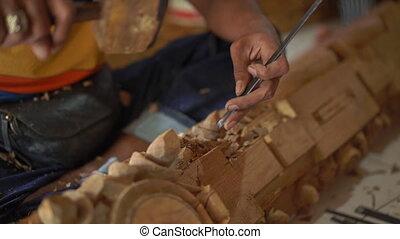 Slowmotion closeup shot of a master craftsman doing ...
