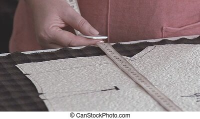 Slowmotion. Cutting fabrics. The material in the cell. Cotton fabric