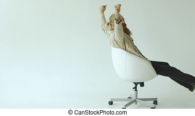 Slowmotion of Bearded businessman have fun turning on office chair on white background