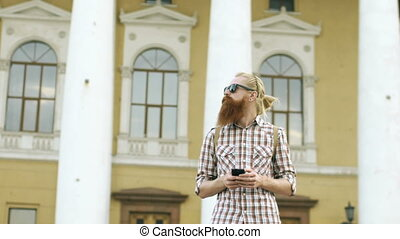 Slowmotion of Bearded tourist man lost in city and using...