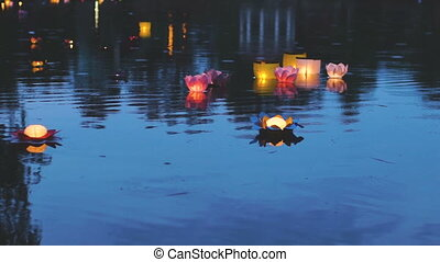 Slowmotion of water glowing lanterns festival on the river in Asia