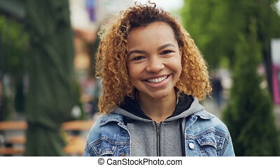Slowmotion portrait of attractive African American girl...