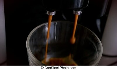 Slowmotion pouring coffee into a glass of coffee  professional machine