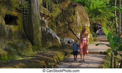 Slowmotion shot of a family visiting the Gunung Kawi Sebatu...