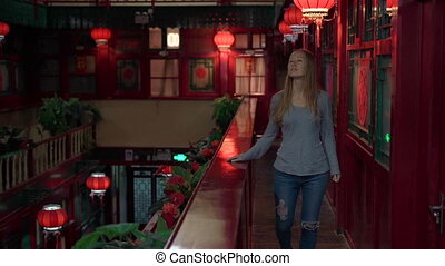 Slowmotion shot of a Happy woman tourist enjoying vacation in China. Travel to China concept. Visa free transit 72 hours, 144 hours in China.